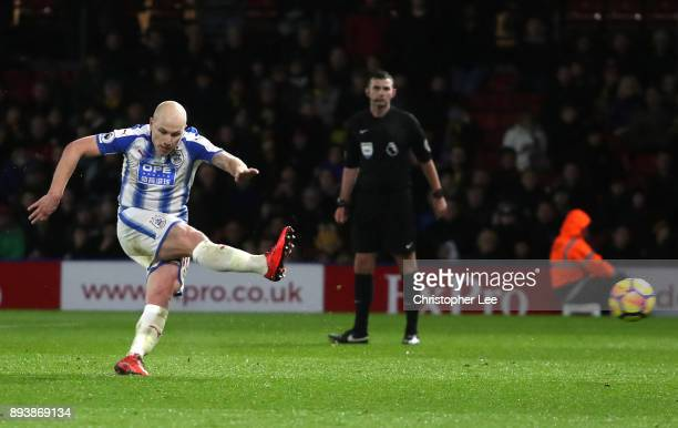 Aaron Mooy of Huddersfield Town scores his sides fourth goal during the Premier League match between Watford and Huddersfield Town at Vicarage Road...