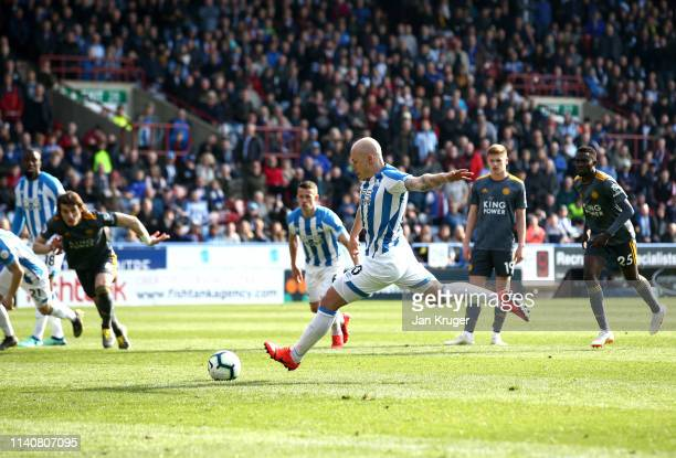 Aaron Mooy of Huddersfield Town scores his team's first goal from the penalty spot during the Premier League match between Huddersfield Town and...
