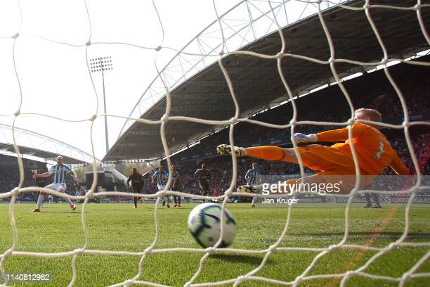 Aaron Mooy of Huddersfield Town scores his team's first goal from the penalty spot past Kasper Schmeichel of Leicester City during the Premier League...