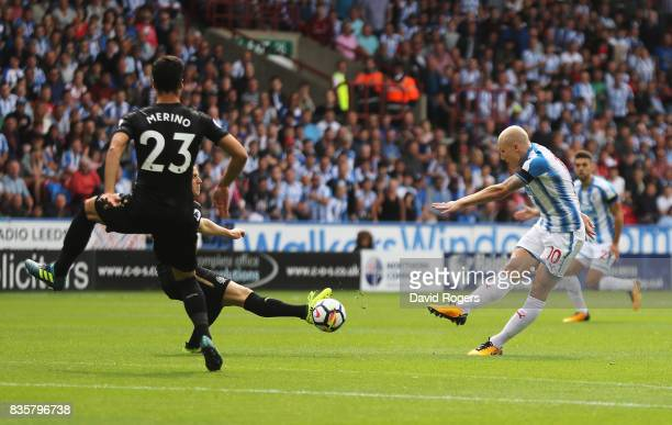 Aaron Mooy of Huddersfield Town shoots during the Premier League match between Huddersfield Town and Newcastle United at John Smith's Stadium on...