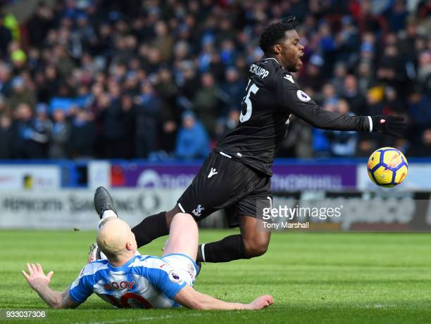 Aaron Mooy of Huddersfield Town tackles Jeffrey Schlupp of Crystal Palace during the Premier League match between Huddersfield Town and Crystal...