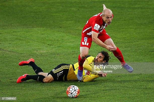 Aaron Mooy of Melbourne City beats the challenge of Albert Riera of the Phoenix during the round 21 ALeague match between the Wellington Phoenix and...