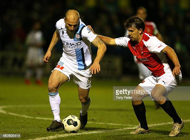 Aaron Mooy of Melbourne City contests the ball with Patrick Wheeler of Edgeworth during the FFA Cup match between Edgeworth FC and Melbourne City FC...