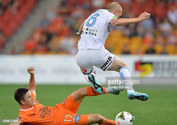 Aaron Mooy of Melbourne City is tackled by Matthew McKay of the Roar during the round five ALeague match between the Brisbane Roar and Melbourne City...