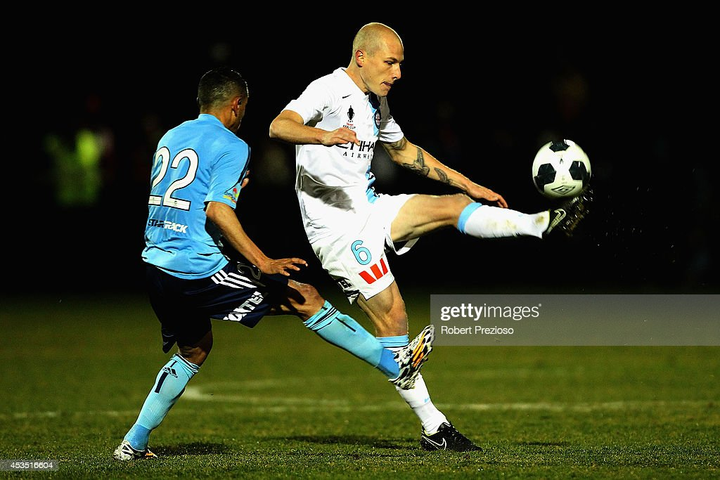 Aaron Mooy of Melbourne City passes the ball during the FFA Cup match between Melbourne City and Sydney FC at Morshead Park Stadium on August 12, 2014 in Ballarat, Australia.