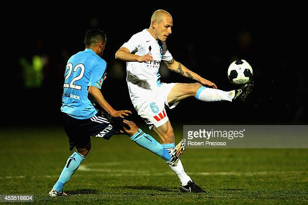 Aaron Mooy of Melbourne City passes the ball during the FFA Cup match between Melbourne City and Sydney FC at Morshead Park Stadium on August 12 2014...