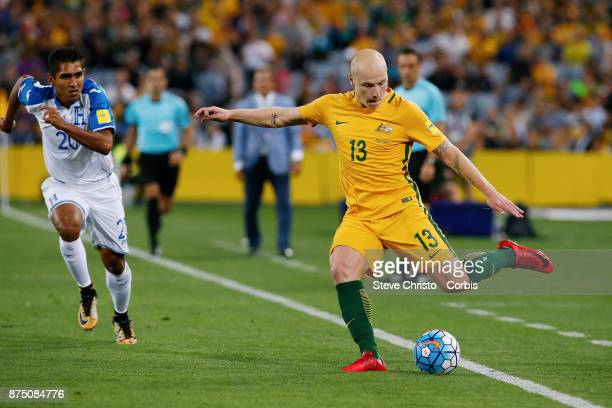 Aaron Mooy of the Australia gets past Jorge Claros of Honduras during the 2nd leg of the 2018 FIFA World Cup Qualifier between the Australia and...