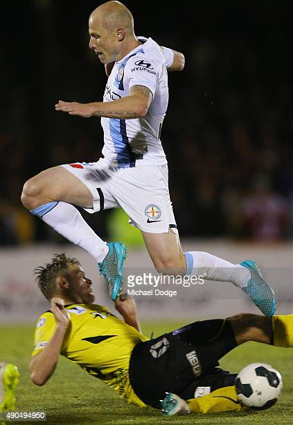 Aaron Mooy of the City competes for the ball over Jack Petrie of United during the FFA Cup Quarter Final match between Heidleberg United and...