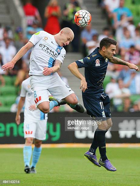 Aaron Mooy of the City headers the ball over Anthony Caceres of the Mariners during the round three ALeague match between Melbourne City FC and the...