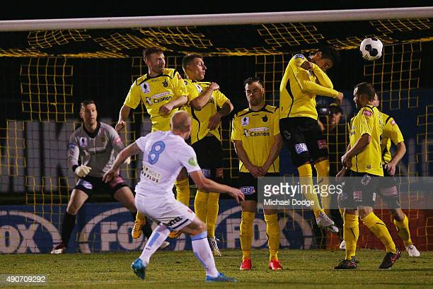 Aaron Mooy of the City kicks the ball at goal during the FFA Cup Quarter Final match between Heidleberg United and Melbourne City FC at Olympic...