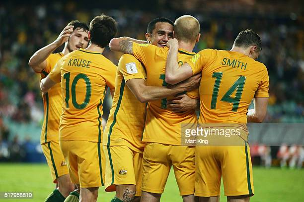 Aaron Mooy of the Socceroos celebrates with Tim Cahill and Brad Smith after scoring a goal during the 2018 FIFA World Cup Qualification match between...