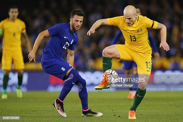 Aaron Mooy of the Socceroos compete for the ball against Andreas Samaris of Greece during the International Friendly match between the Australian...