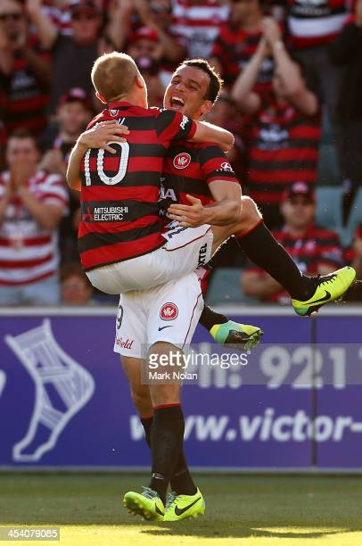 Aaron Mooy of the Wanderers celebrates his goal with team mate Mark Bridge during the round nine ALeague match between the Western Sydney Wanderers...