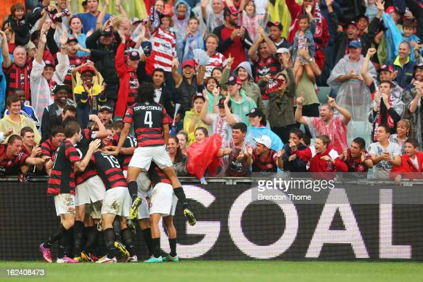 Aaron Mooy of the Wanderers celebrates with team mates after scoring the opening goal during the round 22 ALeague match between the Western Sydney...