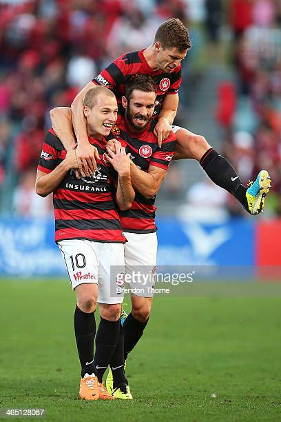 Aaron Mooy of the Wanderers celebrates with team mates Dean Heffernan and Shannon Cole after scoring a goal from a free kick during the round 16...