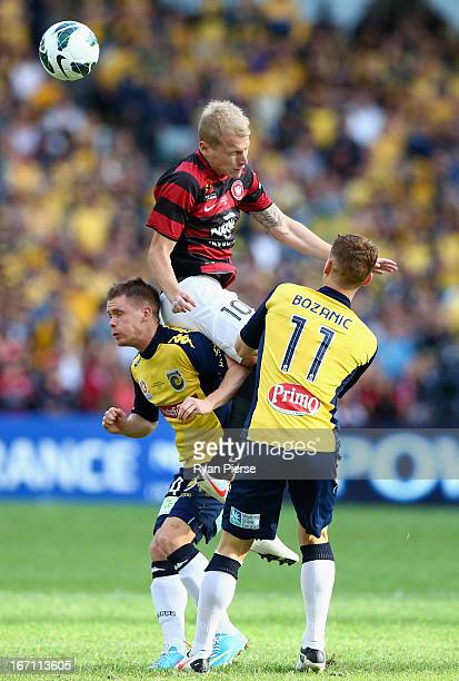 Aaron Mooy of the Wanderers competes for the ball against Pedj Bojic of the Mariners during the ALeague 2013 Grand Final match between the Western...