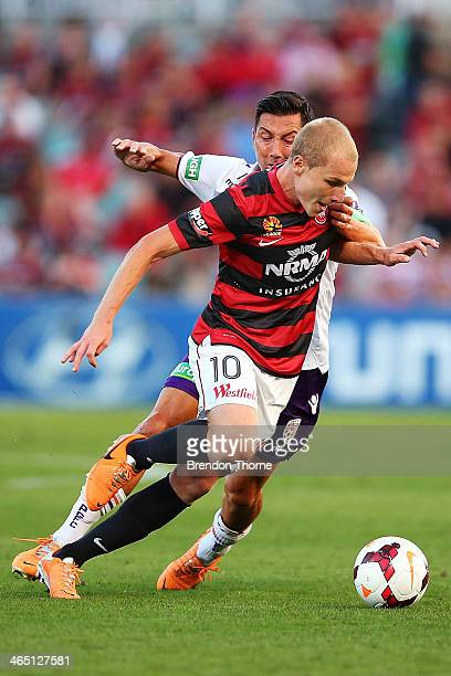 Aaron Mooy of the Wanderers competes with Jacob Burns of the Glory during the round 16 ALeague match between the Western Sydney Wanderers and Perth...