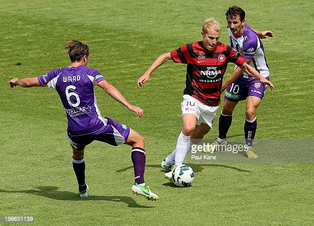 Aaron Mooy of the Wanderers controls the ball against Nick Ward and Liam Miller of the Glory during the round seven ALeague match between Perth Glory...