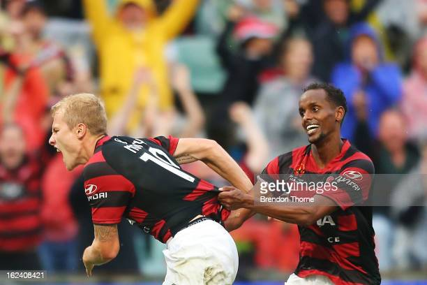 Aaron Mooy of the Wanderers has his jumper pulled by team mate Youssouf Hersi in celebration after scoring the opening goal during the round 22...