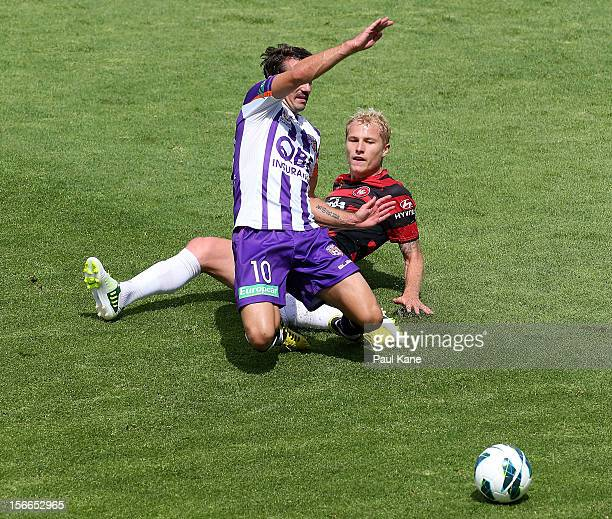 Aaron Mooy of the Wanderers tackles Liam Miller of the Glory during the round seven ALeague match between Perth Glory and the Western Sydney...
