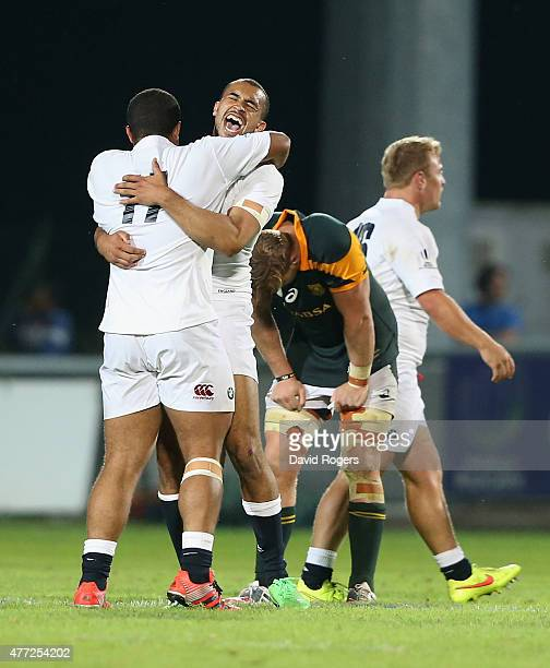 Aaron Morris of England hugs team mate Seb AdeniranOlule after their victory during the World Rugby U20 Championship semi final match between England...