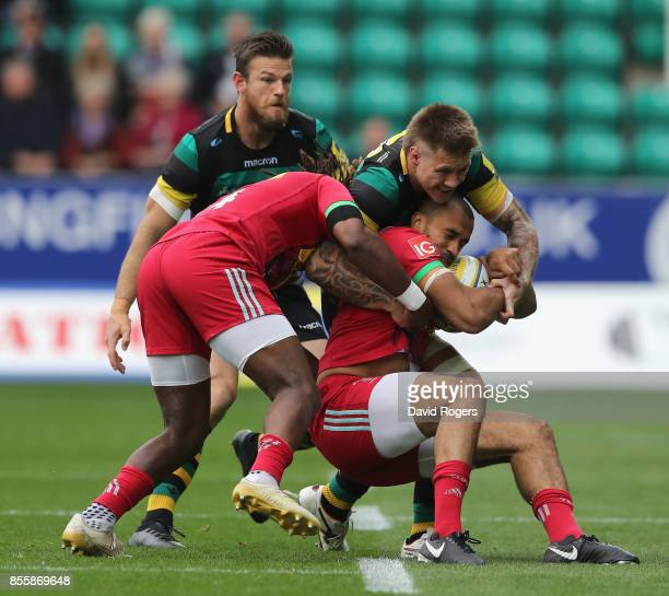 Aaron Morris of Harlequins is tackled by Teimana Harrison during the Aviva Premiership match between Northampton Saints and Harlequins at Franklin's...