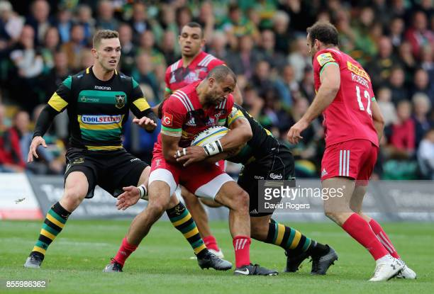 Aaron Morris of Harlequins is tackled during the Aviva Premiership match between Northampton Saints and Harlequins at Franklin's Gardens on September...