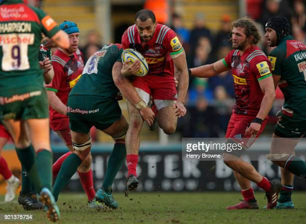 Aaron Morris of Harlequins tackled by Graham Kitchener of Leicester Tigers during the Aviva Premiership match between Leicester Tigers and Harlequins...