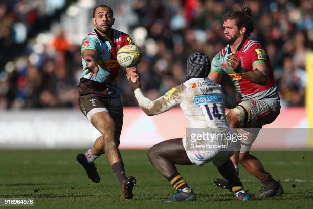 Aaron Morris passes the ball to Luke Wallace of Harlequins during the Aviva Premiership match between Harlequins and Wasps at Twickenham Stoop on...