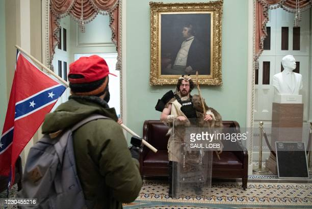 Aaron Mostofsky, a supporter of US President Donald Trump protests in the US Capitol Rotunda on January 6 in Washington, DC. - Demonstrators breeched...