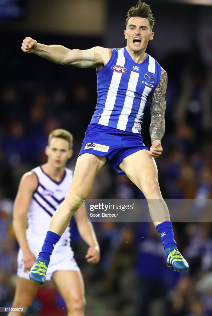 Aaron Mullett of the Kangaroos celebrates after kicking a goal during the round 16 AFL match between the North Melbourne Kangaroos and the Fremantle Dockers at Etihad Stadium on July 9, 2017 in Melbourne, Australia.