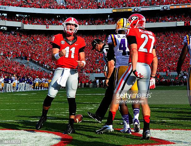 Aaron Murray of the Georgia Bulldogs celebrates after scoring a second quarter touchdown against the LSU Tigers at Sanford Stadium on September 28,...