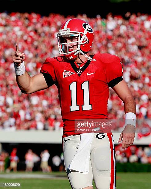 Aaron Murray of the Georgia Bulldogs reacts after passing for a touchdown against the South Carolina Gamecocks at Sanford Stadium on September 10...