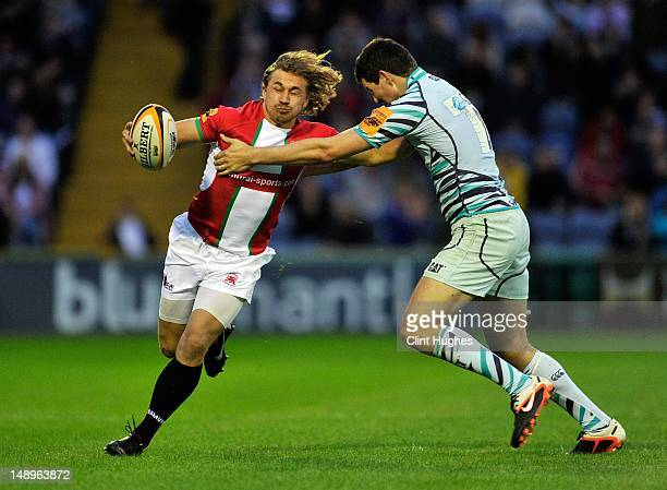 Aaron Myers of London Welsh is tackled by Andy Symons of Leicester Tigers during the JP Morgan Asset Management Premiership Rugby 7's Series 2012...