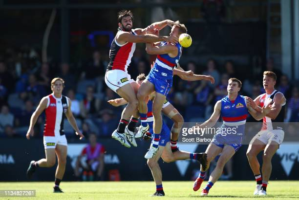 Aaron Naughton of the Bulldogs and Josh Bruce of the Saints compete for the ball during the 2019 JLT Community Series AFL match between the Western...