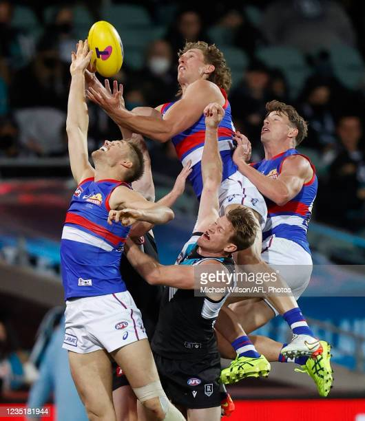 Aaron Naughton of the Bulldogs attempts to mark over Tom Jonas of the Power during the 2021 AFL Second Preliminary Final match between the Port...