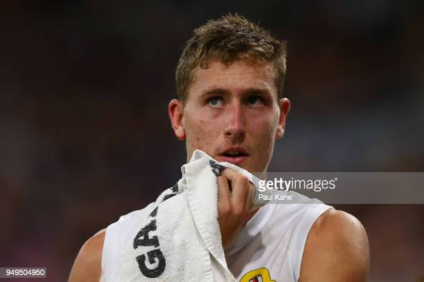 Aaron Naughton of the Bulldogs heads to the rooms for treatment during the round five AFL match between the Fremantle Dockers and the Western...