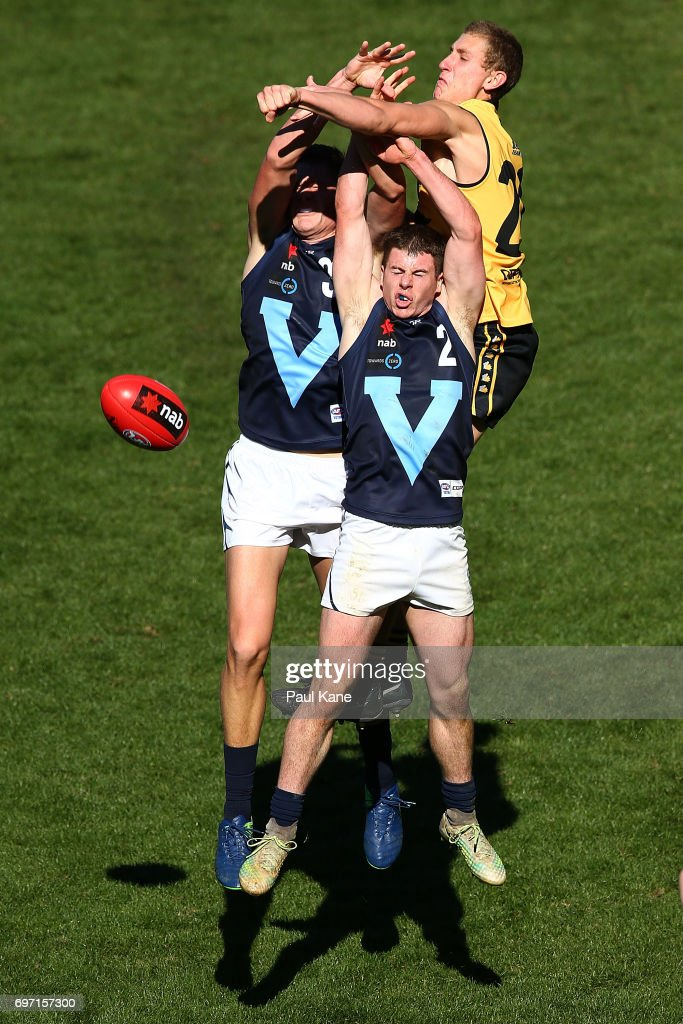Aaron Naughton of Western Australia spoils the mark for Haydyn McLean and Jack Higgins of Vic Metro during the U18 Championships match between Western Australia and Victoria Metro at Domain Stadium on June 18, 2017 in Perth, Australia.