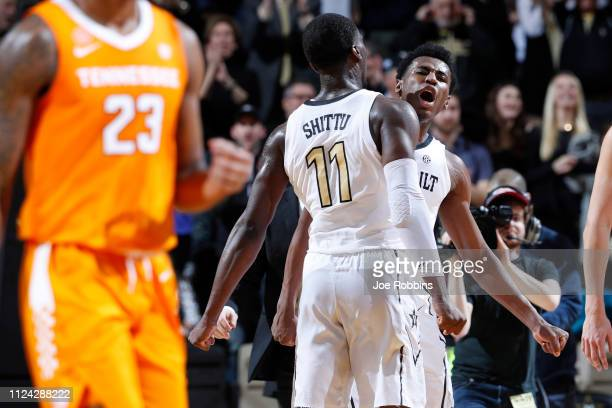 Aaron Nesmith and Simisola Shittu of the Vanderbilt Commodores celebrate in the first half of the game against the Tennessee Volunteers at Memorial...