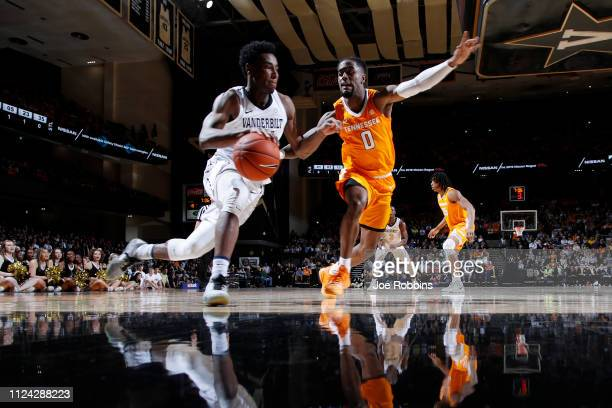 Aaron Nesmith of the Vanderbilt Commodores drives to the basket against Jordan Bone of the Tennessee Volunteers in the first half of the game at...