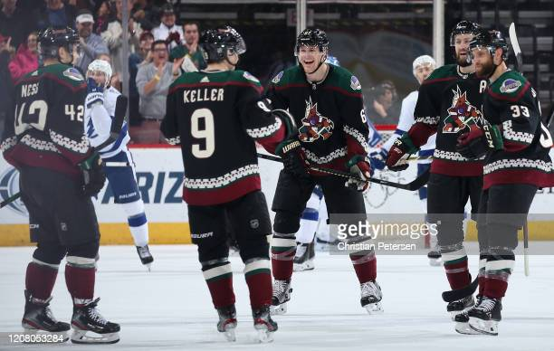 Aaron Ness, Clayton Keller, Lawson Crouse, Derek Stepan and Alex Goligoski of the Arizona Coyotes celebrate after Keller scored a goal against the...
