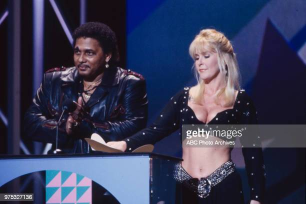 Aaron Neville Lita Ford presenting on the 17th Annual American Music Awards Shrine Auditorium January 22 1990