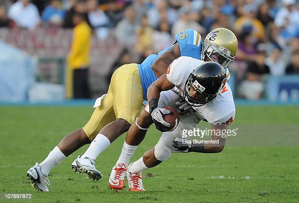 Aaron Nichols of the Oregon State Beavers is tackled by Andrew Abbott of the UCLA Bruins at The Rose Bowl on November 6 2010 in Pasadena California