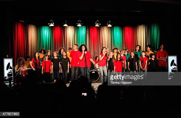 Aaron Nigel Smith 1 World Chorus and School of Rock perform at The GRAMMY Museum on June 20 2015 in Los Angeles California
