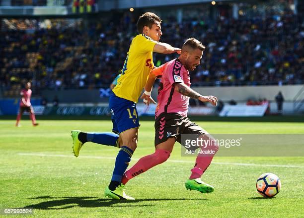 Aaron Niguez of CD Tenerife being followed by Khalifa Brian Olivan of Cadiz CF during La Liga Segunda Division between Cadiz CF and CD Tenerife at...