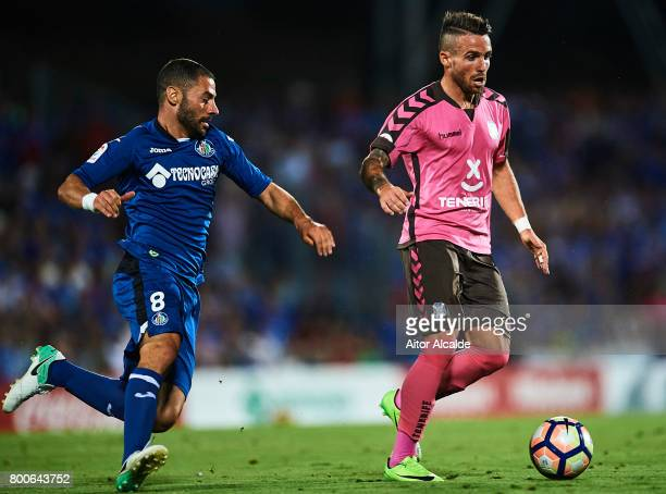 Aaron Niguez of CD Tenerife being followed by Mehdi Laceng of Getafe CF during La Liga 2 play off round between Getafe and CD Tenerife at Coliseum...