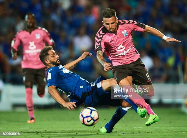 Aaron Niguez of CD Tenerife being fouled by Sergio Mora of Getafe CF during La Liga 2 play off round between Getafe and CD Tenerife at Coliseum...