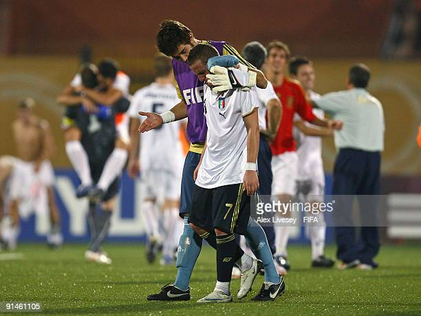 Aaron Niguez of Spain leaves the pitch in tears as he is consoled by goalkeeper Tomas Mejias after their 1:3 defeat to Italy in the FIFA U20 World...