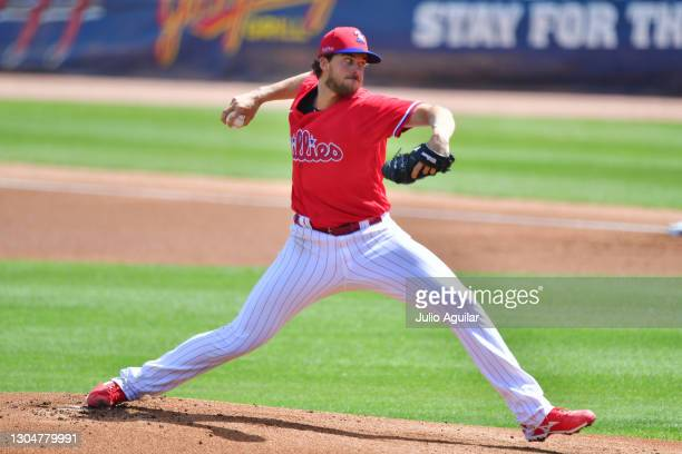 Aaron Nola of the Philadelphia Phillies delivers the first pitch in the first inning against the Baltimore Orioles during a spring training game at...