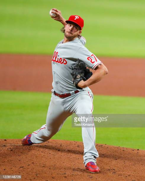 Aaron Nola of the Philadelphia Phillies delivers the pitch in the first inning of an MLB game against the Atlanta Braves at Truist Park on August 21,...